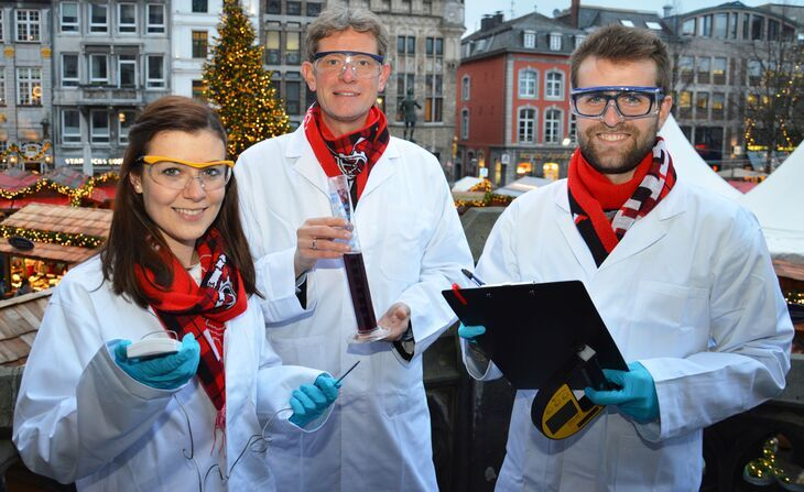 People showing their test results at the christmas market